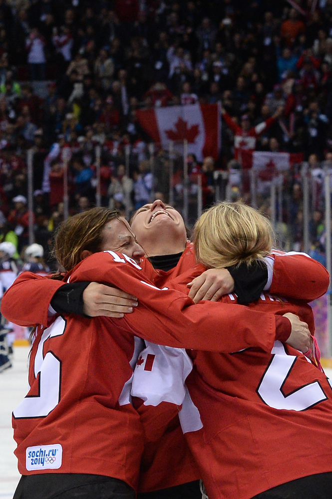 Canada's players celebrate after winning the Women's Ice Hockey Gold Medal Game between Canada and USA at the Bolshoy Ice Dom