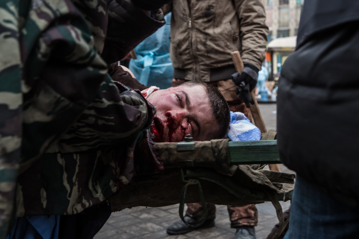<br>A wounded anti-government protester is carried to a waiting ambulance on Feb. 20, 2014, in Kiev, Ukraine. After several w