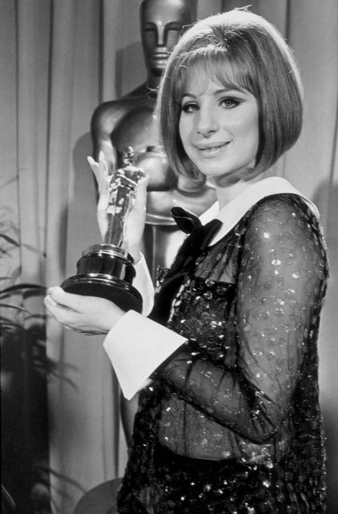 Barbra Streisand wearing a see-through sequined Scaasi pantsuit at the 41st annual Academy Awards in 1969.