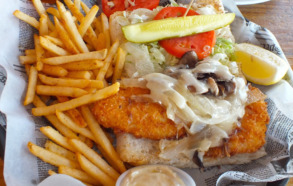 Hogfish is a delicate fish with a scallop-like flavor. It works beautifully in this local classic sandwich topped with swiss