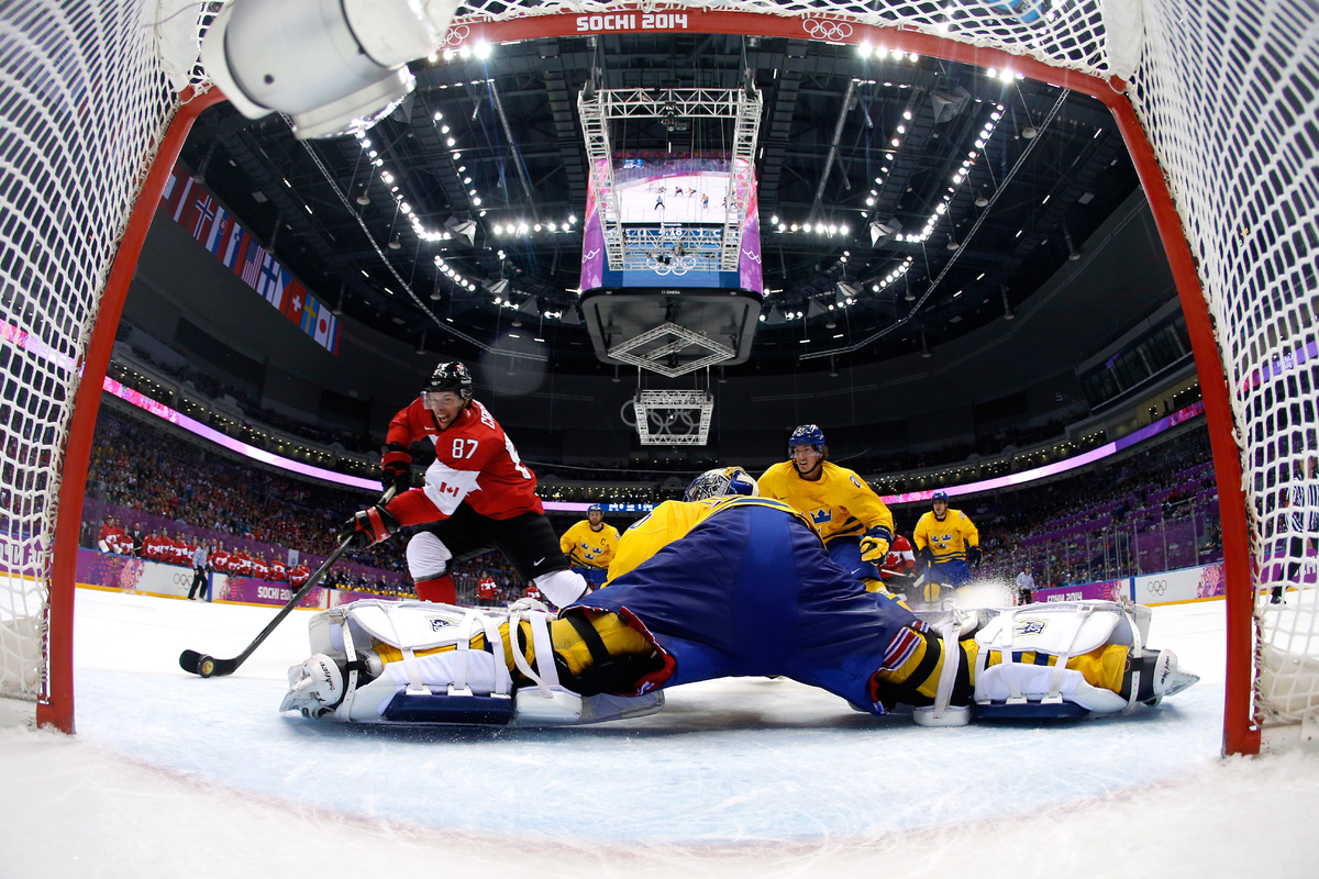 SOCHI, RUSSIA - FEBRUARY 23:  Sidney Crosby #87 of Canada scores his team's second goal past Henrik Lundqvist #30 of Sweden i
