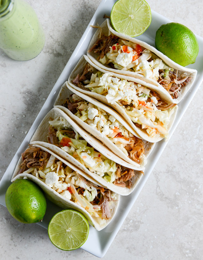 "<strong>Get the <a href=""http://www.howsweeteats.com/2013/10/pulled-pork-tacos-with-sweet-chili-slaw/"" target=""_blank"">Pulled"