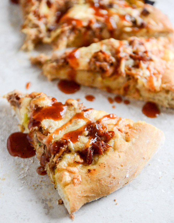 "<strong>Get the <a href=""http://www.howsweeteats.com/2013/12/pulled-pork-pizza-with-maple-leeks-roasted-garlic-and-aged-chedd"