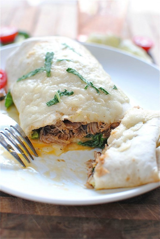"<strong>Get the <a href=""http://bevcooks.com/2012/07/slow-cooker-pork-burritos/"" target=""_blank"">Pulled Pork Burrito recipe</"