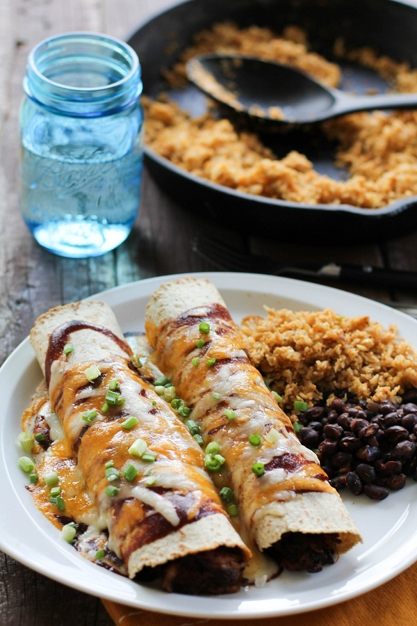 "<strong>Get the <a href=""http://www.theroastedroot.net/bbq-pulled-pork-enchiladas/"" target=""_blank"">BBQ Pork Enchiladas recip"