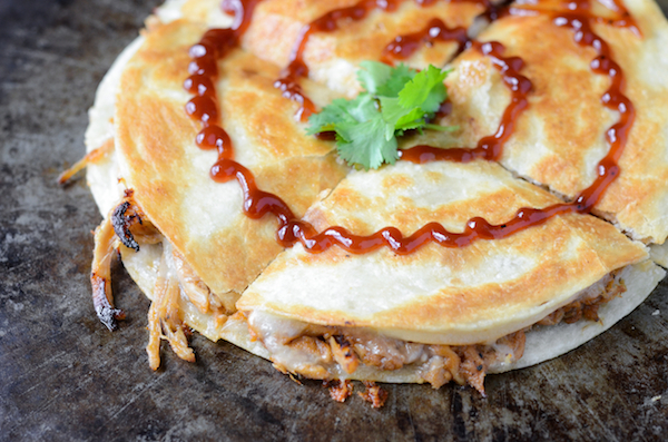 "<strong>Get the <a href=""http://www.thenovicechefblog.com/2013/08/pulled-pork-and-caramelized-onion-quesadillas/"" target=""_bl"