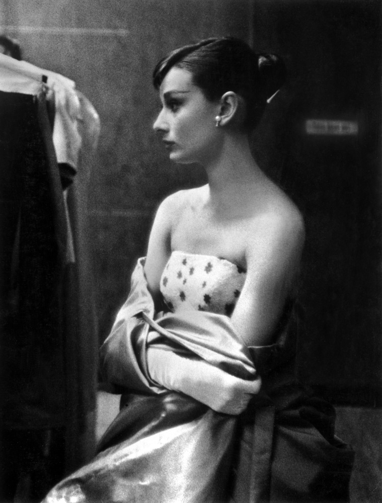 Audrey Hepburn in Paramount's portrait gallery dressing room prior to attending the 27th annual Academy Awards in 1955.
