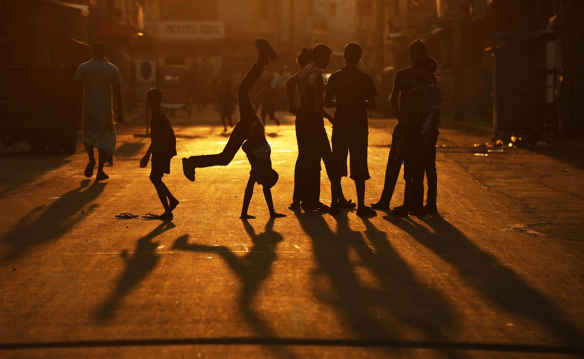 Sri Lankan children play on a road in Colombo, Sri Lanka, Sunday, Jan. 20, 2013. (Eranga Jayawardena/AP)