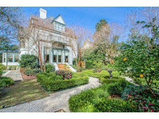 The gardens attached to this seven bedroom, seven bath home -- redone after Katrina -- have citrus trees and grapes. There's