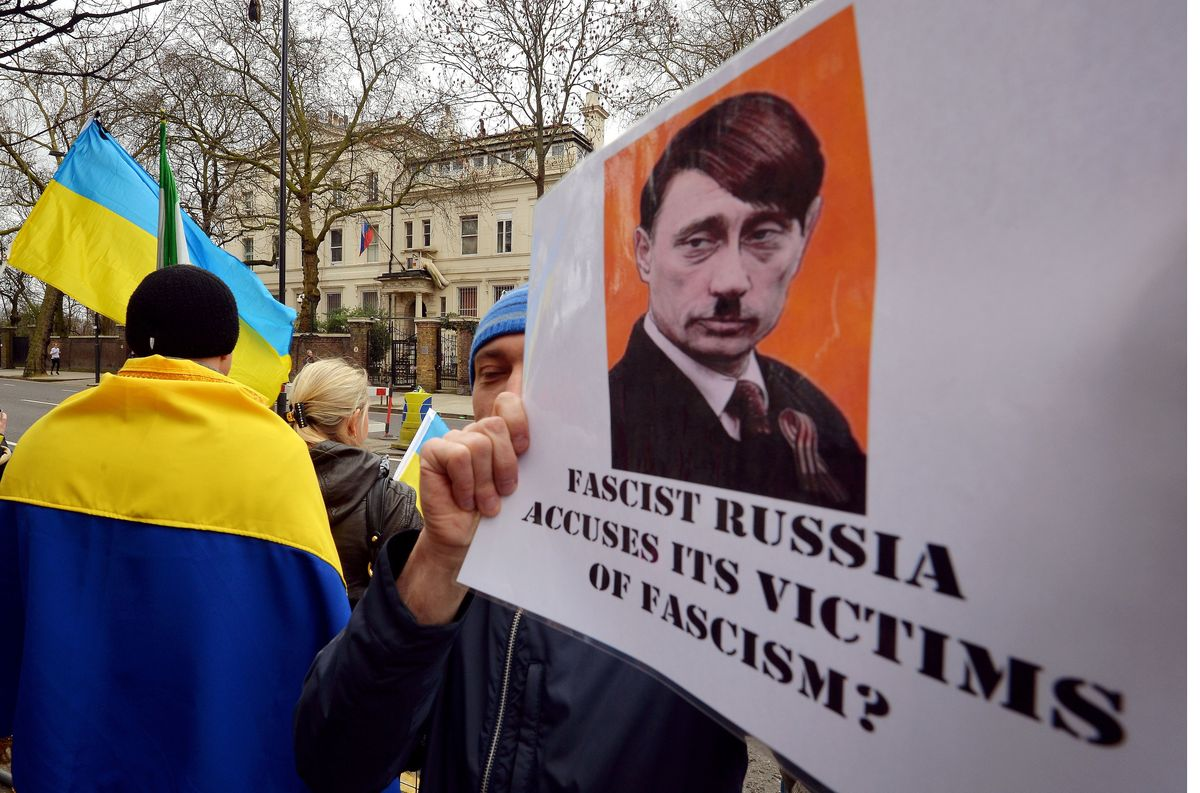 British-based Ukrainians gather outside the Russian Embassy in London to protest against the build-up of troops in the Crimea