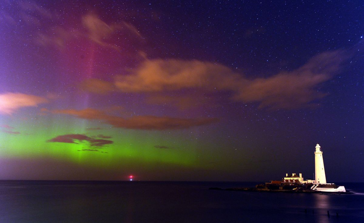 The aurora borealis, or the northern lights as they are commonly known, at St. Mary's Lighthouse and Visitor Centre, Whitley