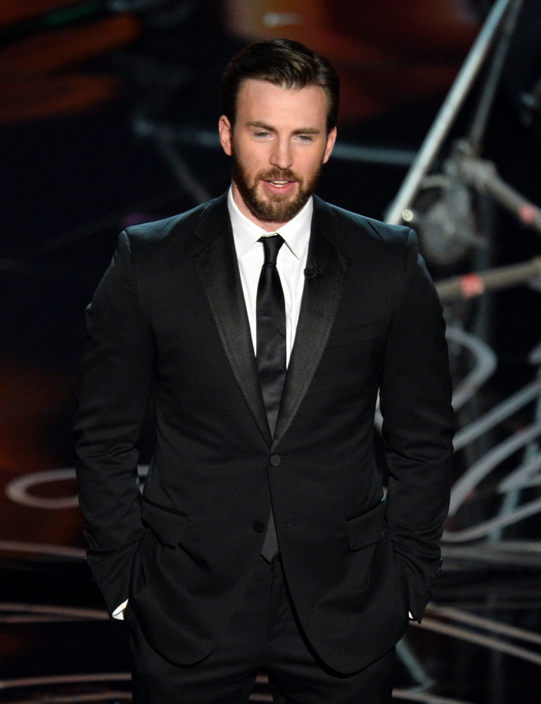 HOLLYWOOD, CA - MARCH 02:  Actor Chris Evans speaks onstage during the Oscars at the Dolby Theatre on March 2, 2014 in Hollyw