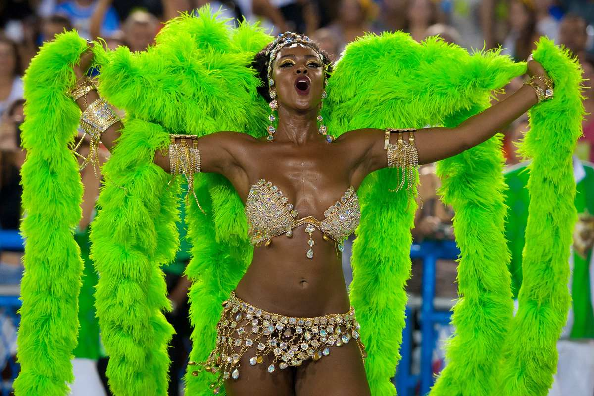 Cris Vianna, Queen of Percussion of Imperatriz Leopoldinense samba school, performs during its parade at 2014 Brazilian Carni
