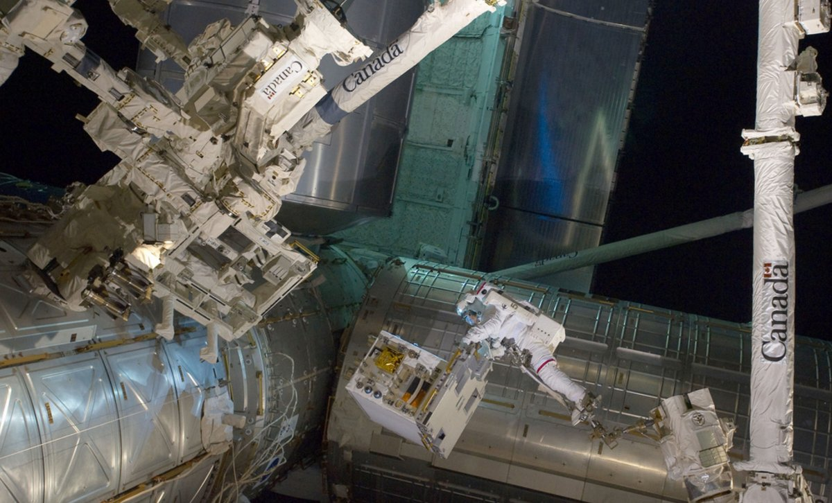 NASA image captured July 12, 2011 - With his feet secured on a restraint on the space station remote manipulator system's rob