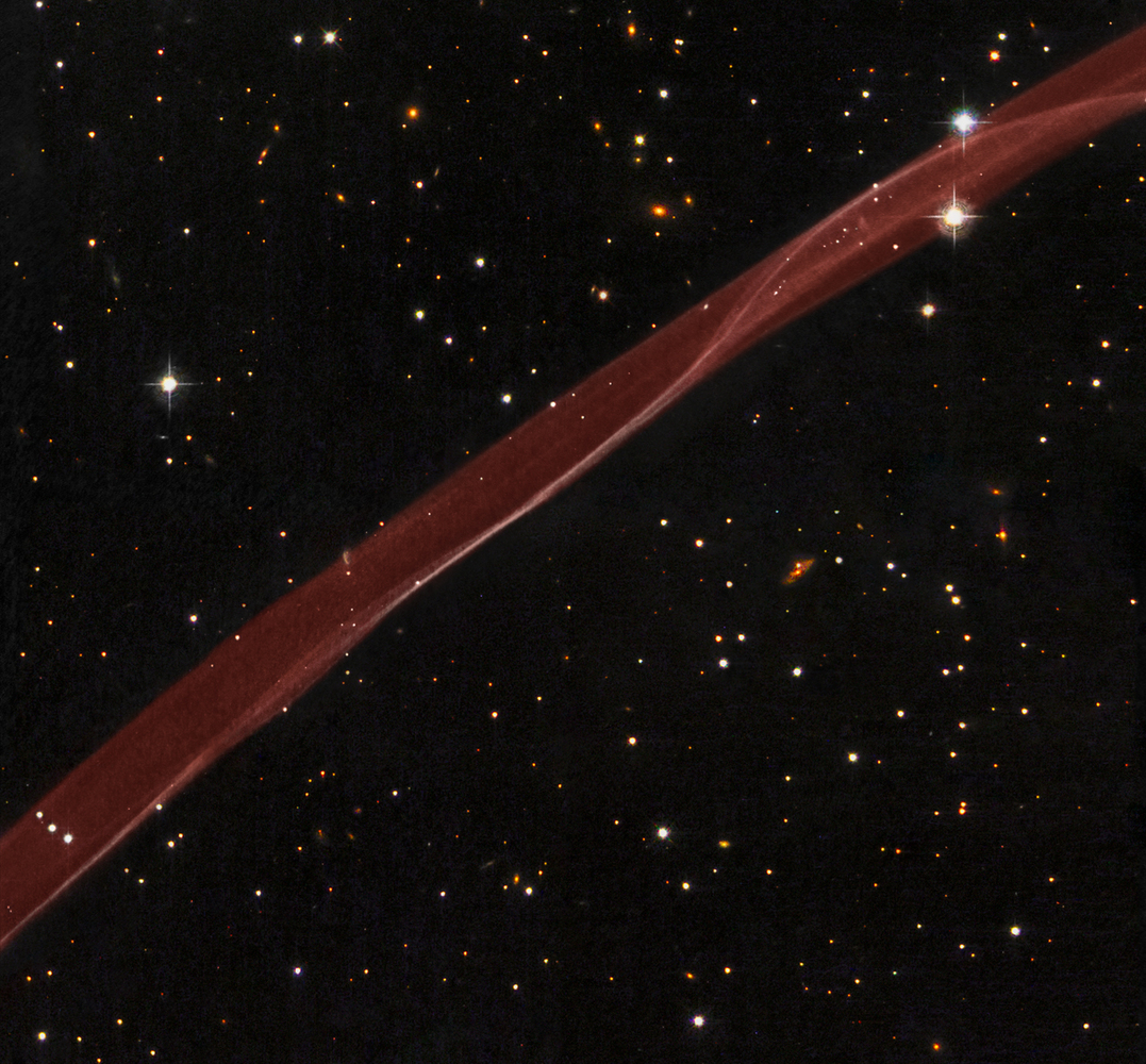 A delicate ribbon of gas floats eerily in our galaxy. A contrail from an alien spaceship? A jet from a black-hole? Actually t