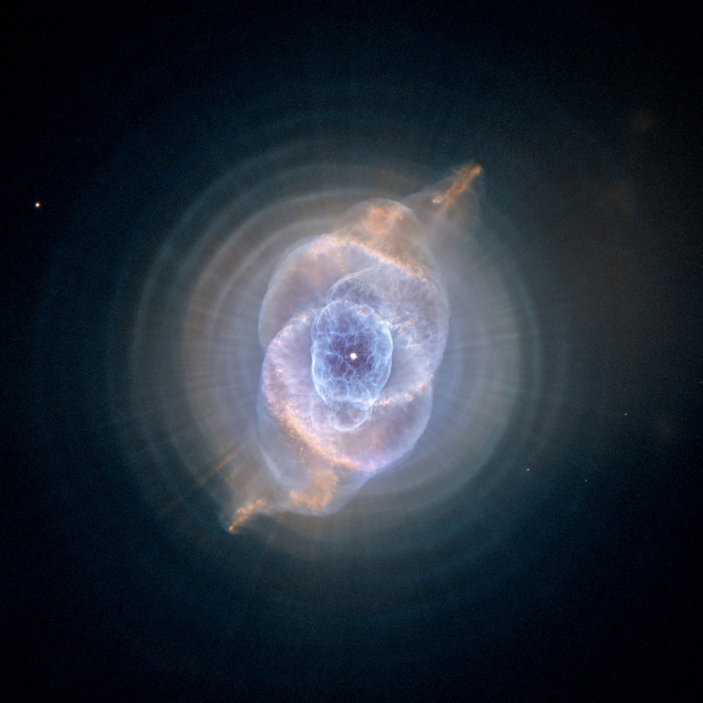 The Cat's Eye Nebula, one of the first planetary nebulae discovered, also has one of the most complex forms known to this kin