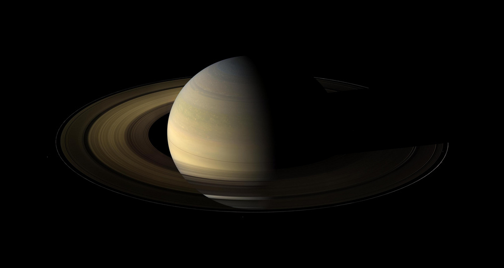 As Saturn's rings orbit the planet, a section is typically in the planet's shadow, experiencing a brief night lasting from 6