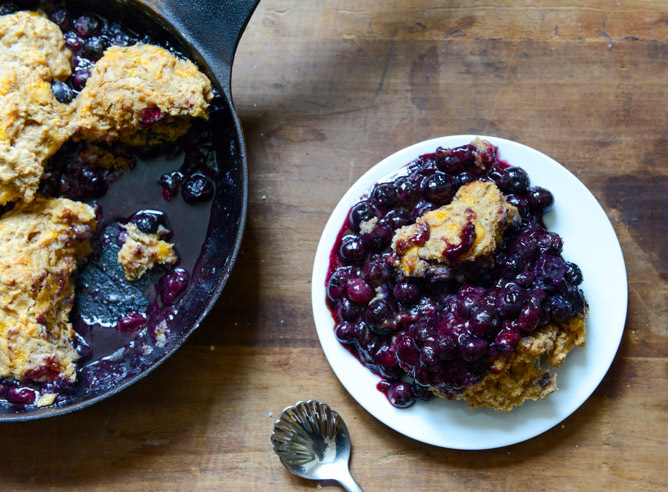 """<strong>Get the <a href=""""http://www.howsweeteats.com/2013/08/skillet-blueberry-cobbler-with-a-cheddar-biscuit-crust/"""" target="""