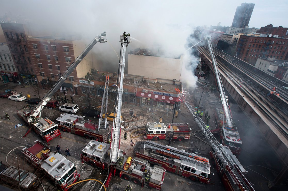 <em>Firefighters battle a fire after a building collapses in the East Harlem neighborhood of New York, Wednesday, March 12, 2