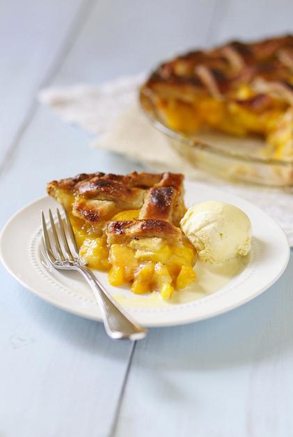 "<strong>Get the <a href=""http://www.annies-eats.com/2012/07/16/peach-pie/"" target=""_blank"">Peach Pie recipe</a> from Annie's"