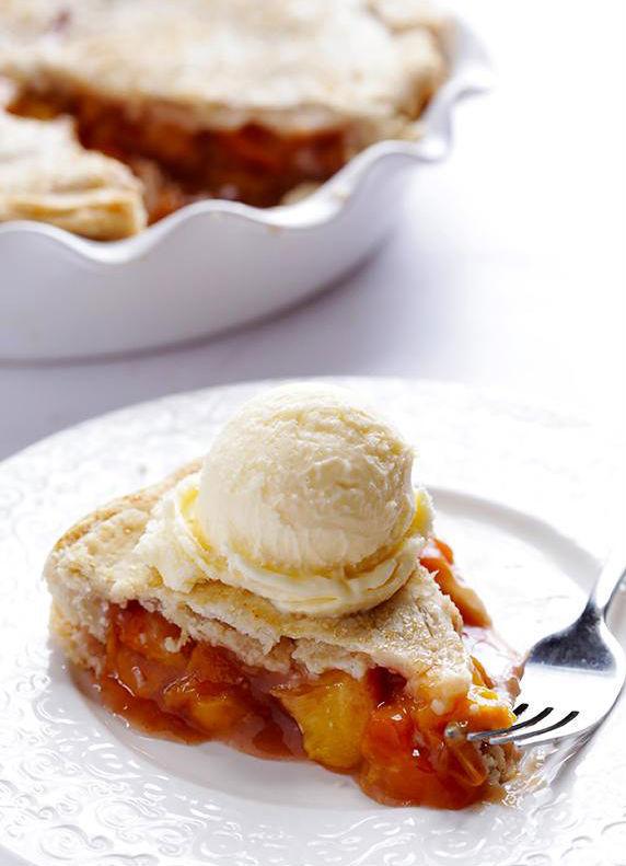 "<strong>Get the <a href=""http://www.gimmesomeoven.com/peach-bourbon-pie/"" target=""_blank"">Peach Bourbon Pie recipe</a> form G"