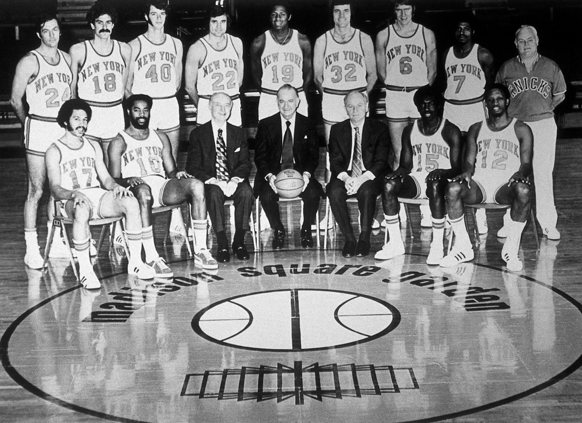 The 1972-73 World Champions of basketball New York Knicks pose for a team portrait at Madison Square Garden in New York, NY i