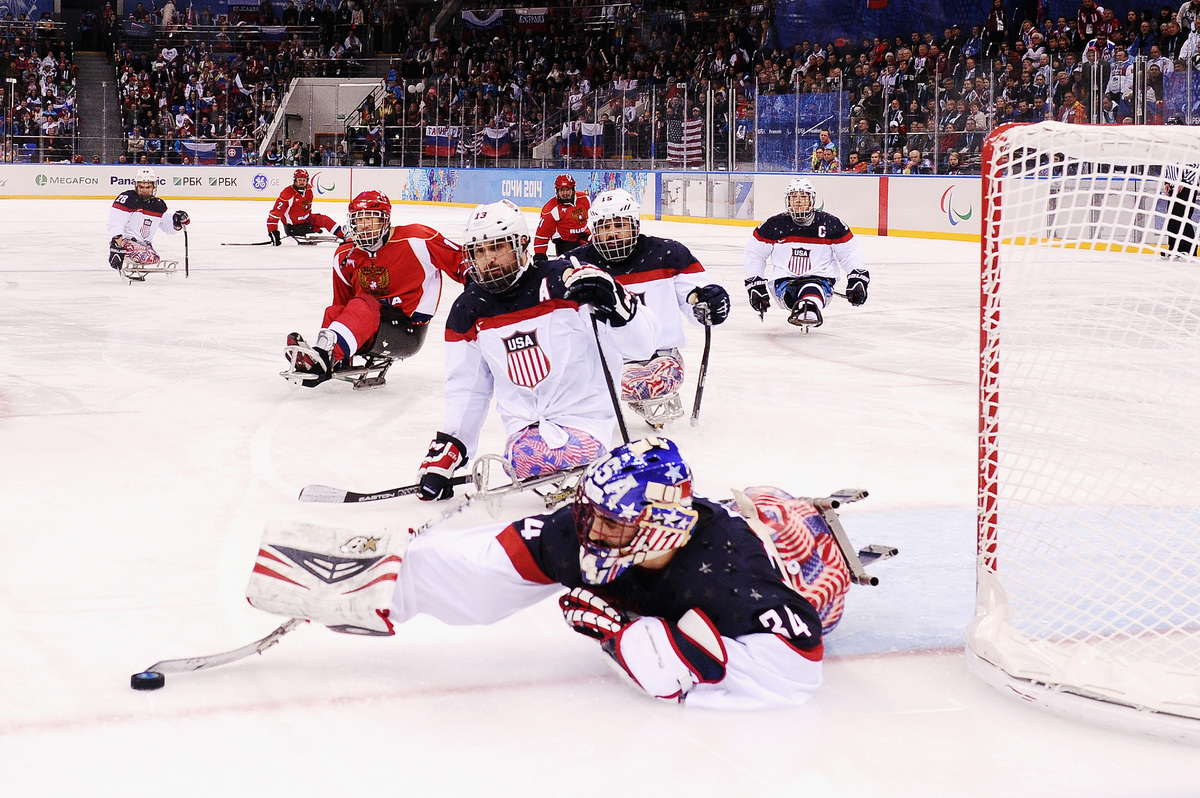 SOCHI, RUSSIA - MARCH 15:  Goalkeeper Steve Cash of the United States stretches for the puck during the ice sledge hockey gol