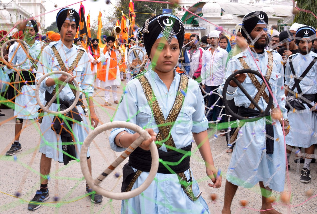 Sikh youths demonstrate Gatka martial arts skills during a procession to mark 'Hola Mohalla' at the Golden Temple in Amritsar