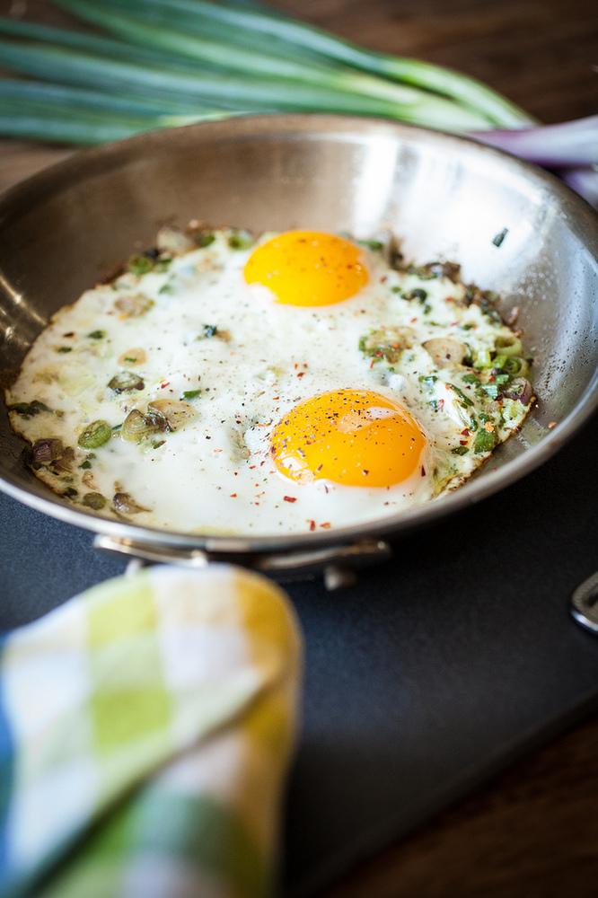 "<strong>Get the <a href=""http://crepesofwrath.net/2013/05/01/spring-garlic-fried-eggs/"" target=""_blank"">Spring Garlic Fried E"