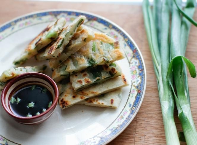 """<strong>Get the <a href=""""http://www.athoughtforfood.net/spring-garlic-pancakes/"""" target=""""_blank"""">Spring Garlic Pancakes recip"""