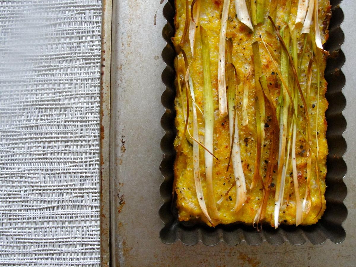"<strong>Get the <a href=""http://food52.com/recipes/17246-spring-onion-polenta-tart"" target=""_blank"">Spring Onion Polenta Tart"