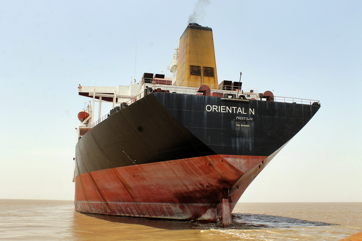 In this June 30, 2012 file photo, the Exxon Valdez is anchored some six nautical miles off the Bhavnagar coast near Alang shi