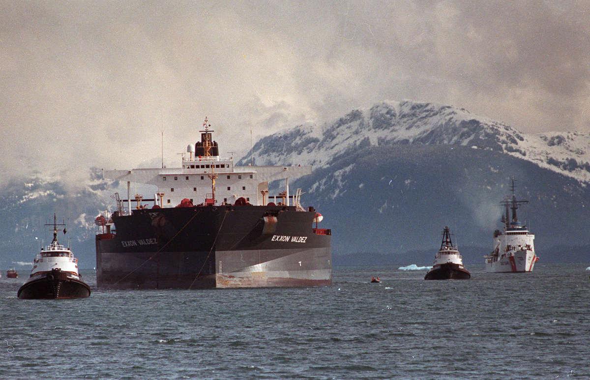 In this June 23, 1989 file photo, the Exxon Valdez is towed out of Prince William Sound in Alaska by a tug boat and a U.S. Co