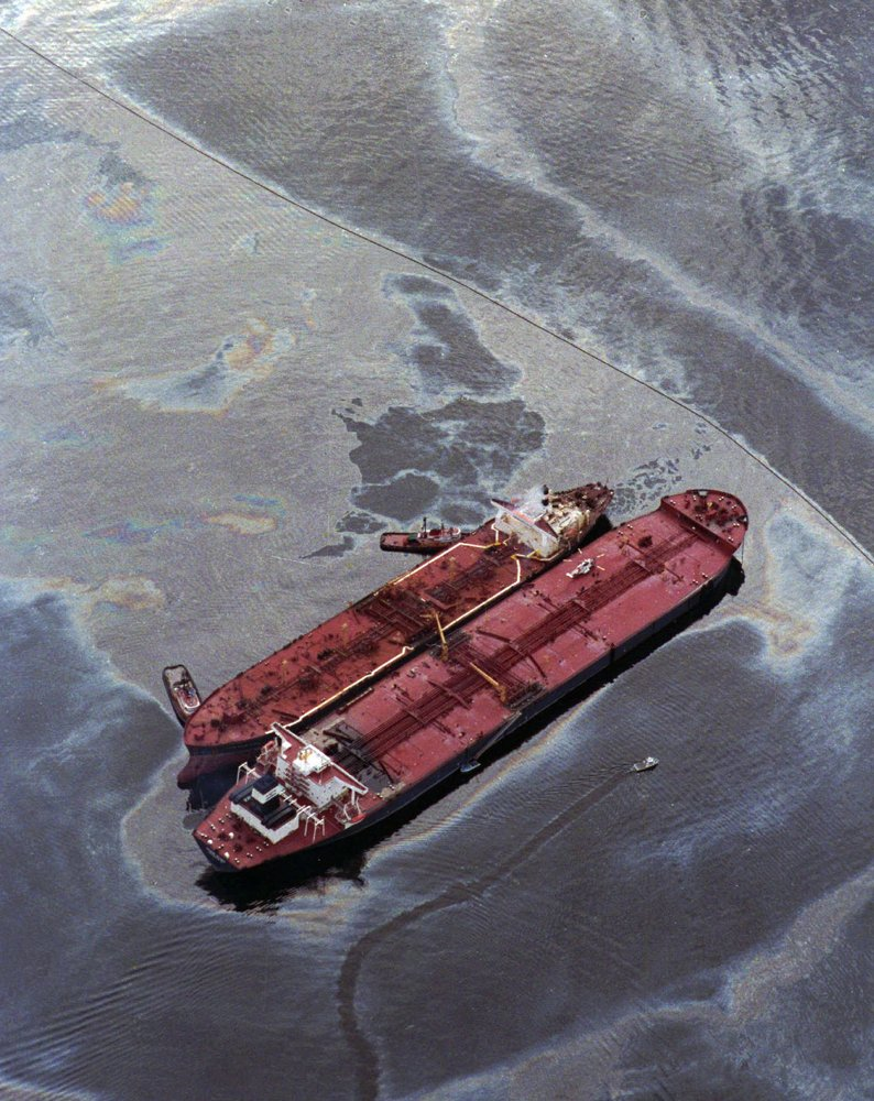 This March 26, 1989 file photo shows the Exxon Baton Rouge (smaller ship) attempting to off load crude oil from the Exxon Val