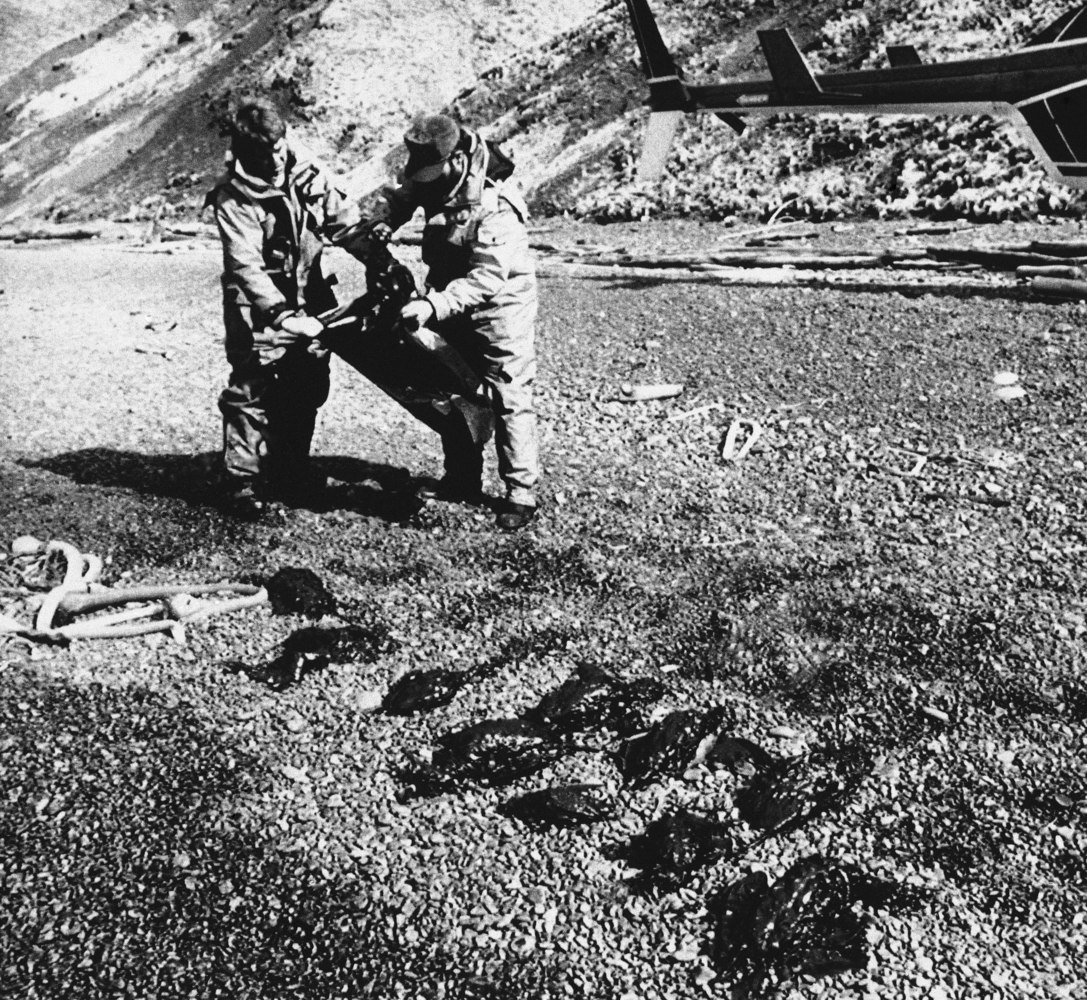 Two staffers with the Alaska Department of Environmental Conservation are pictured patrolling the beach, May 1, 1989, in Anch