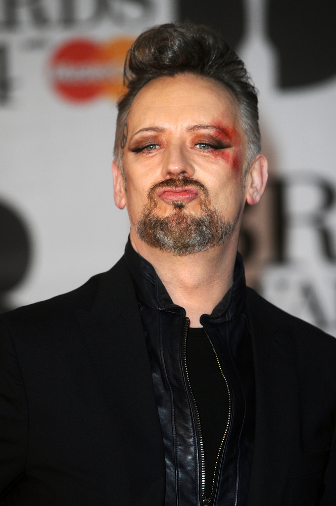 LONDON, ENGLAND - FEBRUARY 19:  Singer Boy George attends The BRIT Awards 2014 at 02 Arena on February 19, 2014 in London, En