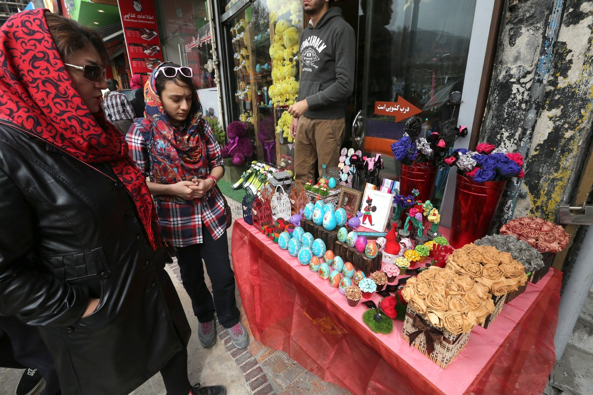 Iranian women shop for Noruz, the Persian New Year, at a market in Tehran on 19 March 2014. Iranians are preparing to celebra