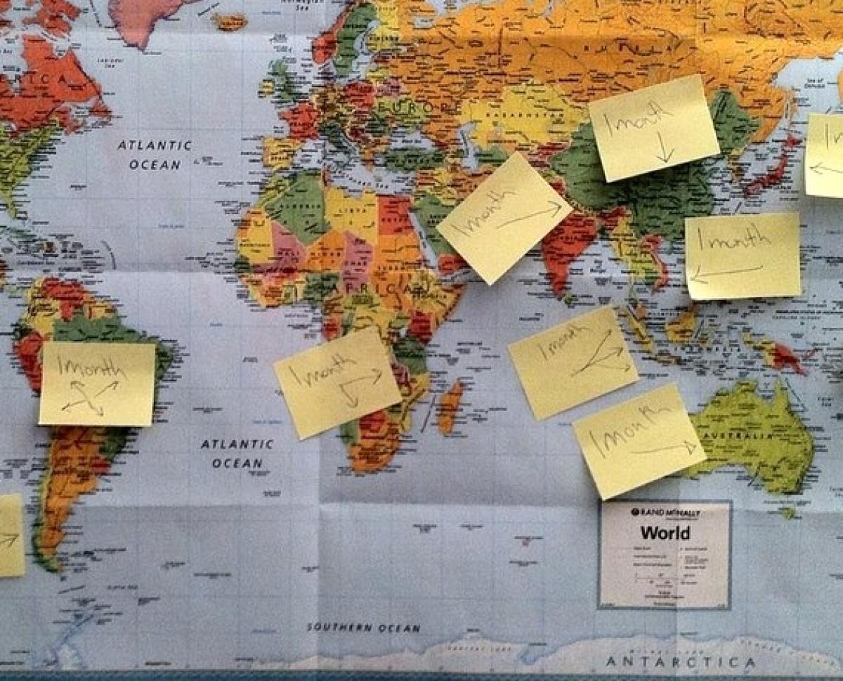 "To initially plan <a href=""http://www.honeytrek.com"" target=""_hplink"">HoneyTrek</a> we got a map and put the Post-Its on all"