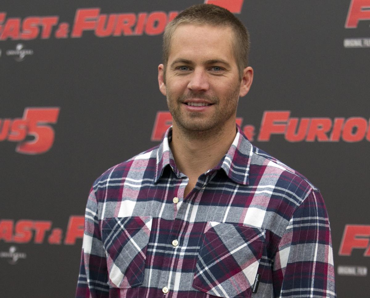 """En esta foto del 29 de abril del 2011, el actor Paul Walker posa con motivo de la presentación del filme """"Fast and Furious 5"""""""