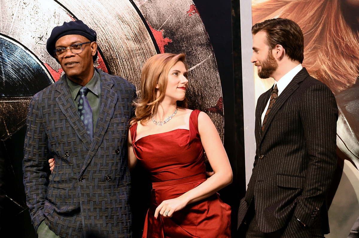 LONDON, ENGLAND - MARCH 20:  (L-r) Actors Samuel L Jackson, Scarlett Johansson and Chris Evans attend the UK Film Premiere of