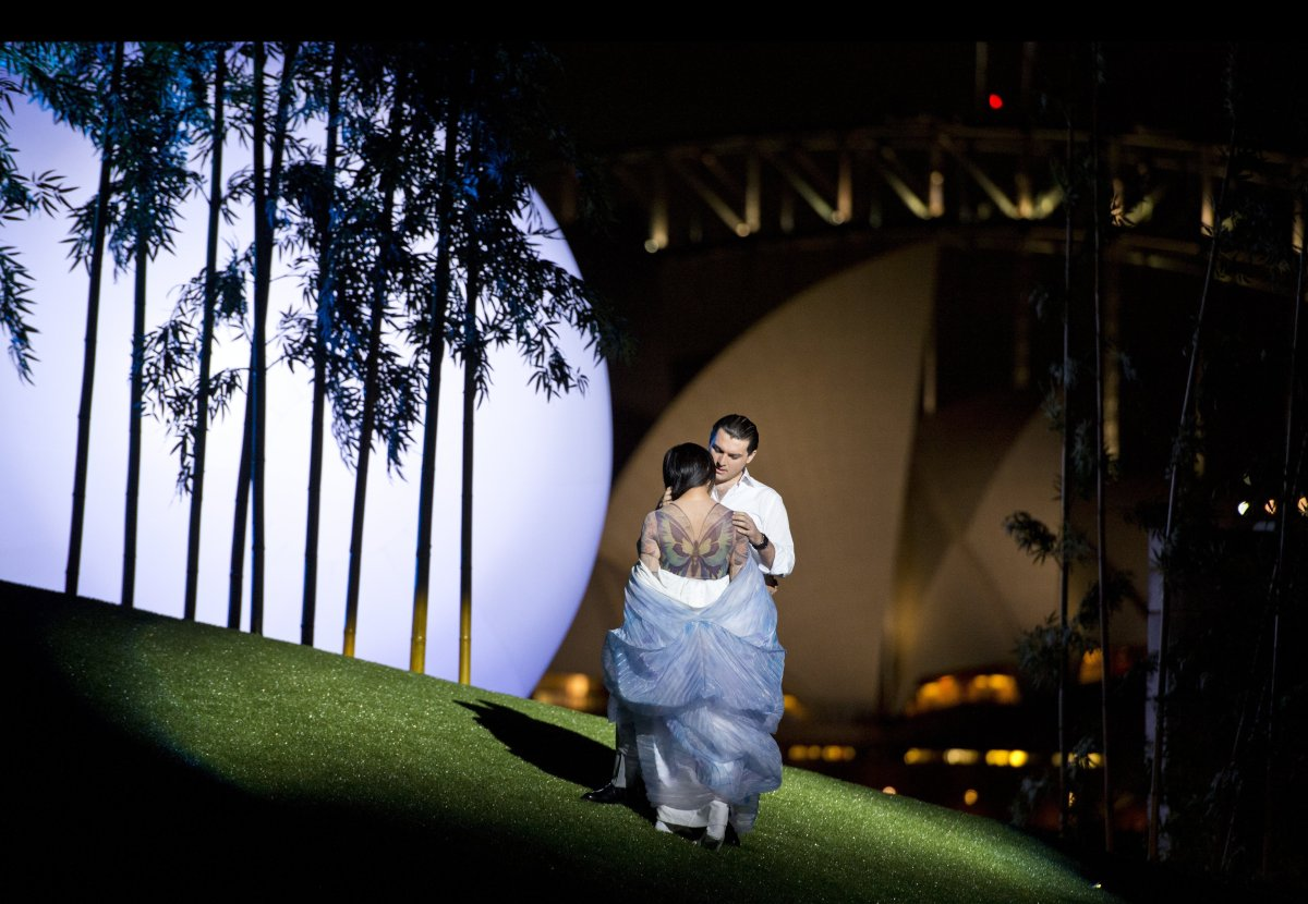 A giant moon rises behind lovers Cio-Cio-San  (Hiromi Omura) and Pinkerton (Georgy Vasiliev) on a set designed by Alfons Flor