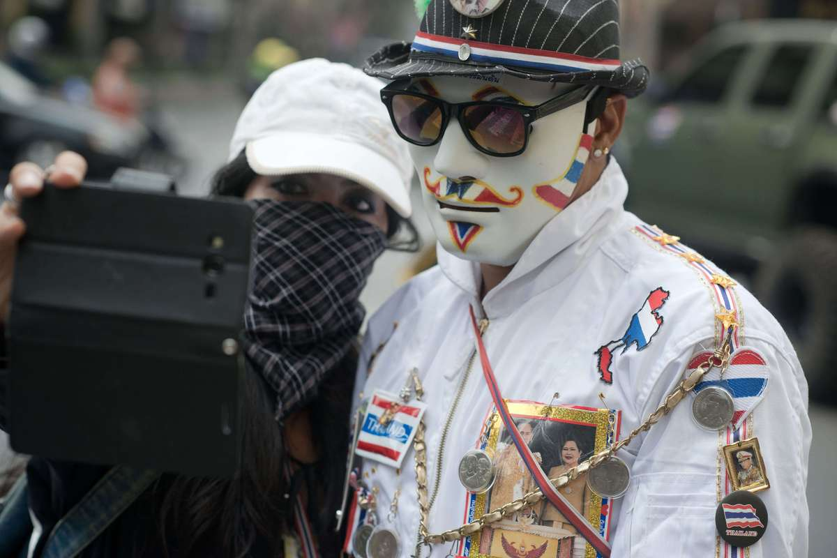 Thai anti-government protesters take a 'selfie' picture with a smart phone during a rally in Bangkok on March 24, 2014. (NICO