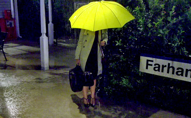 "Baker kept three of the same yellow umbrellas, purchased at Nordstrom, on hand throughout the show. ""The only thing Carter Ba"