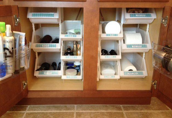 The cabinet under the bathroom sink could be really useful for stowing toiletries—if it weren't for that massive, space-hoggi