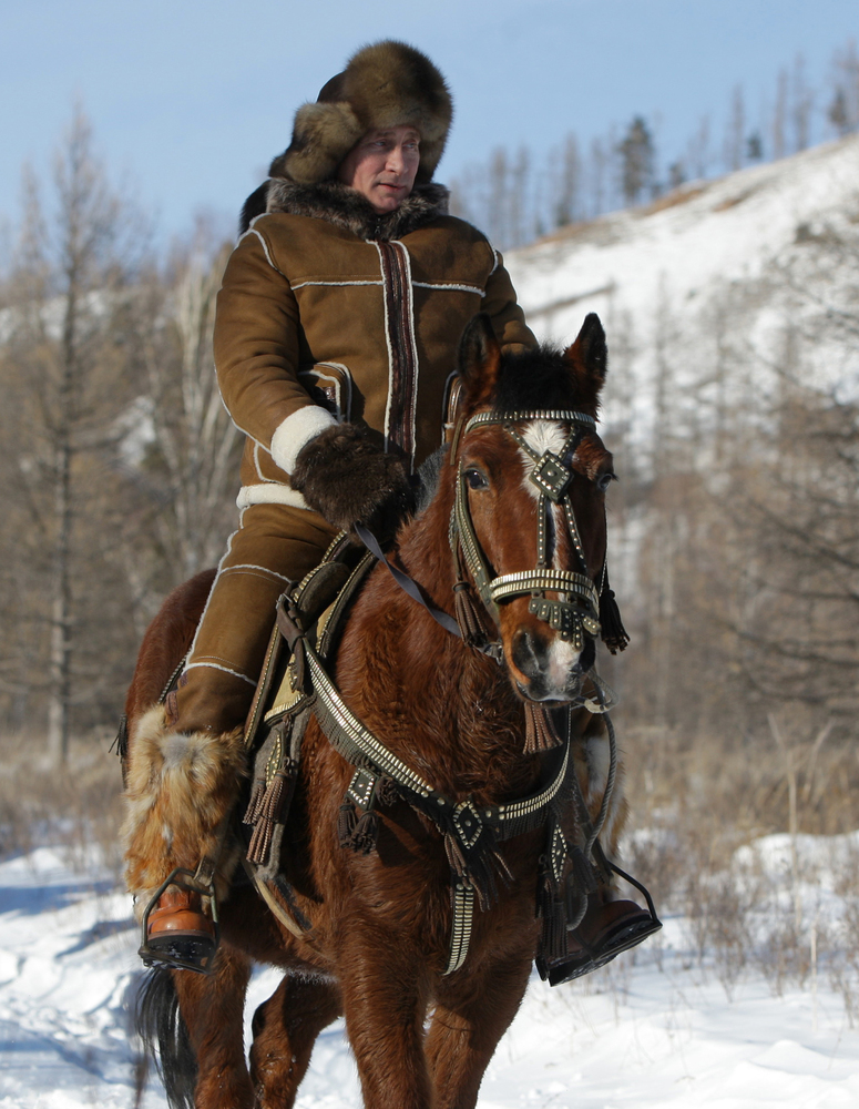 FILE - In this Thursday, Feb. 25, 2010 file photo then Russian Prime Minister Vladimir Putin rides a horse in the foothills o