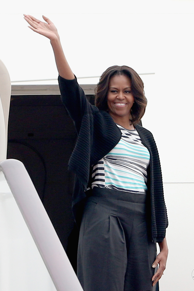 First lady Michelle Obama ended her week-long trip in China on Wednesday looking fresh-faced as ever in a black ribbed jacket