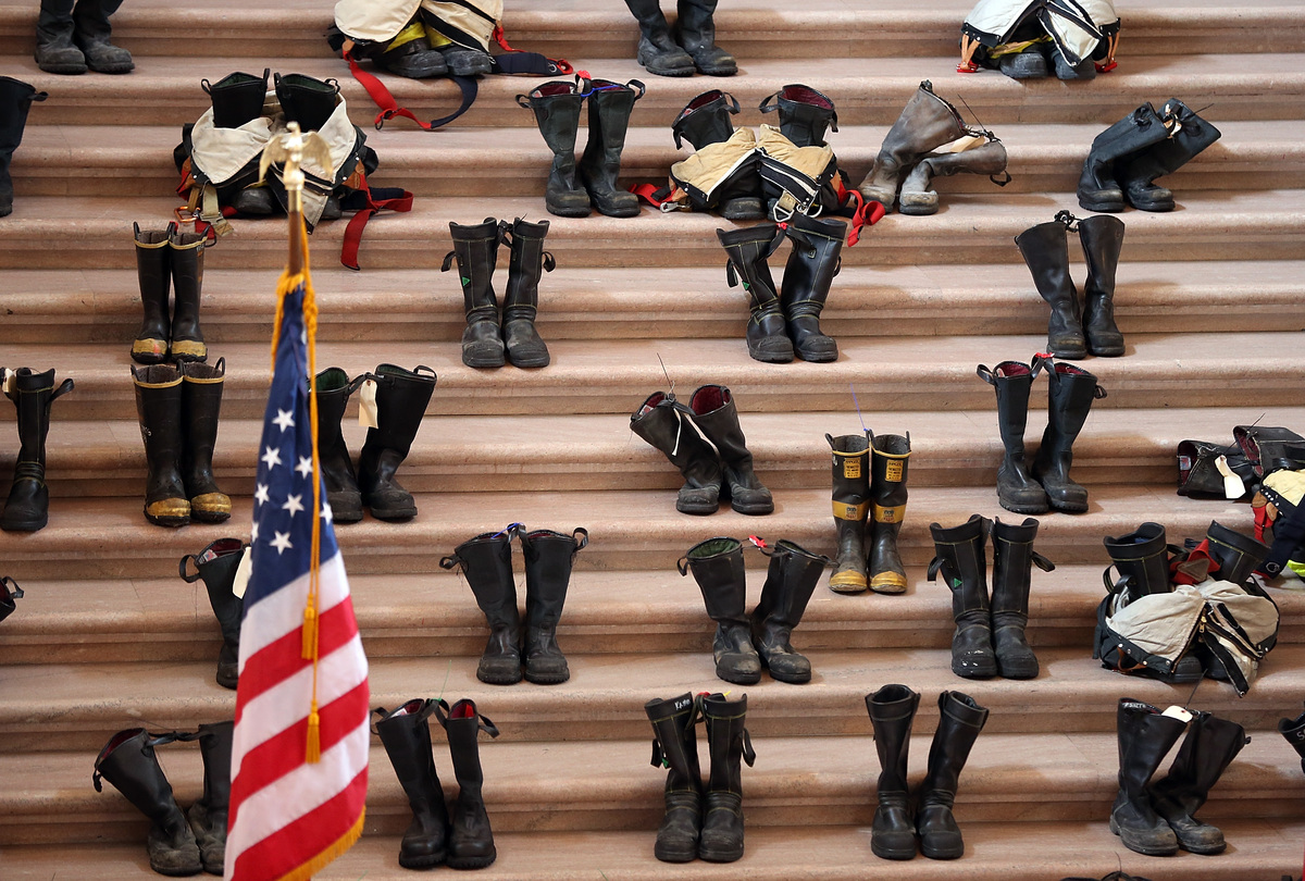SAN FRANCISCO, CA - MARCH 26:  Firefighter boots line the stairs inside San Francisco City Hall during a remembrance ceremony