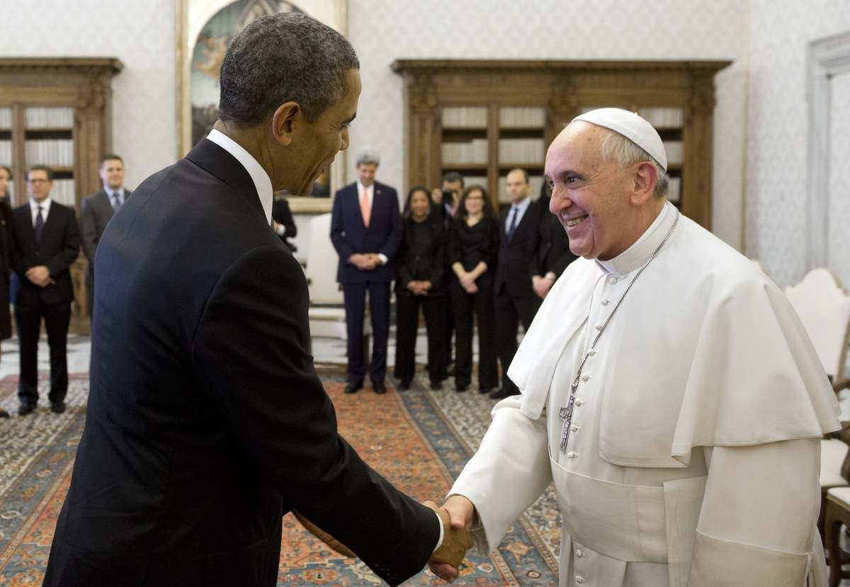 Pope Francis and US President Barack Obama shake hands after exchanging gifts during a private audience on March 27, 2014 at