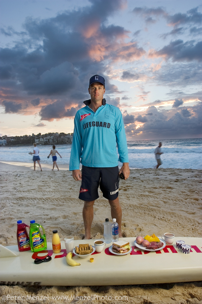 """""""Bruce Hopkins, a Bondi Beach lifeguard, with his typical day's worth of food in Sydney, New South Whales, Australia. The cal"""
