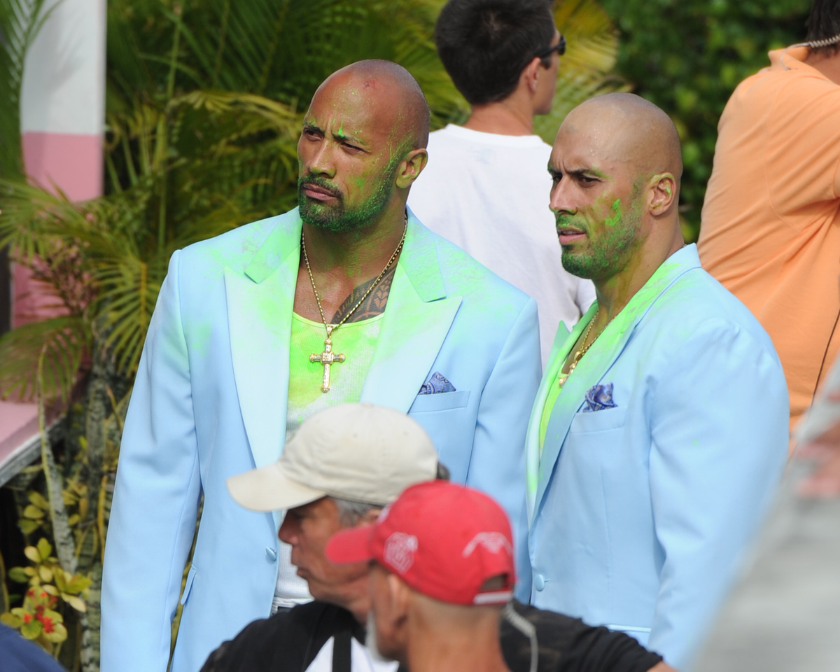 "Dwayne Johnson, left, and his stuntman sighting on the set of ""Pain & Gain"" on April 14, 2012 in Miami."